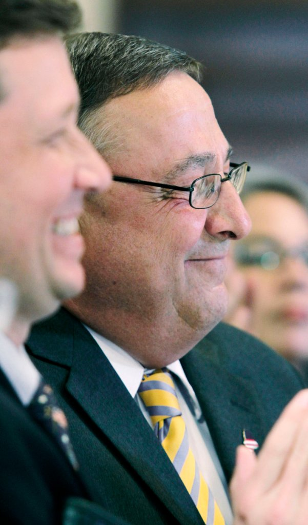 Gov. Paul LePage, right, attends a State House ceremony Wednesday where he signed a bill authorizing the creation of charter schools in Maine. The governor said the schools will offer Maine students greater educational choices. At left is Education Commissioner Stephen Bowen.