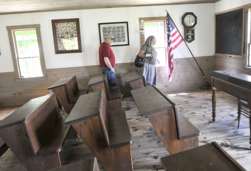 Mike and Karelle Morrissey, of Beverly, Mass., tour the Fenderson School House at 19th Century Willowbrook Village last week. Don King founded the museum to hold his collection of artifacts.