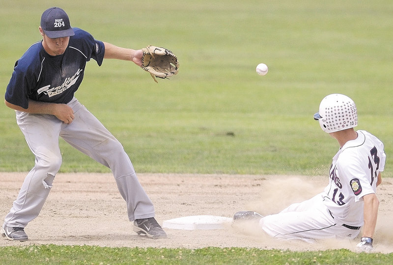 Christian Corneil of Bangor slides safely into second as the throw gets away from Gardiner shortstop Forrest Chadwick.