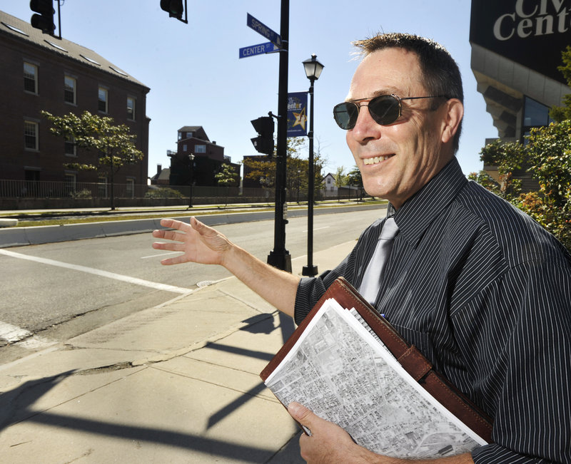Mark Johnson, a member of the Portland Society of Architects, says the Jersey barriers that help divide Spring Street don't belong in an urban setting. The civic center is the dominant building on the street.