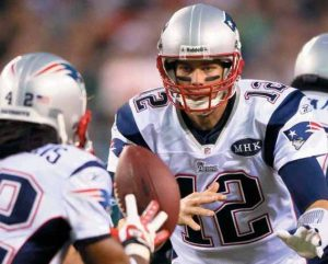 NEW ENGLAND PATRIOTS quarterback Tom Brady (12) pitches the ball to running back Ben- Jarvus Green-Ellis in the first half of an NFL football game against the Philadelphia Eagles in Philadelphia on Sunday.