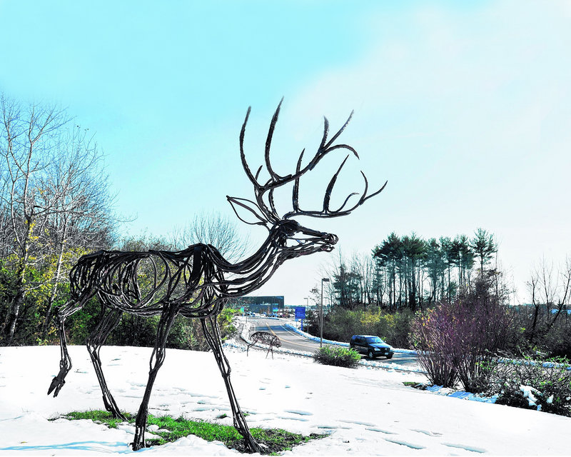 """A public art piece called """"Glimpse,"""" consisting of wildlife sculptures made from wire and steel rods, will be officially unveiled Friday at the Portland jetport and is part of its expansion project."""