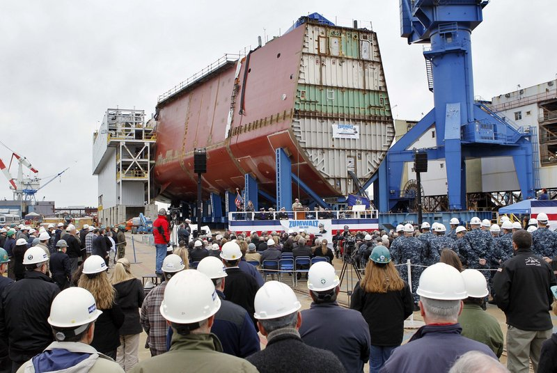 "Bath Iron Works holds a ""laying of the keel"" ceremony to mark the completion of the first hull segment of the future USS Zumwalt. It's the biggest Navy ship built at BIW since delivery of an oil tanker to the Military Sealift Command in 1984 and will be 50 percent larger than current destroyers."
