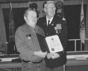 NORMAN OWEN of Brunswick, left, receives a certificate of appreciation for his service during the Vietnam War from Peter Ogden, director of veterans services for the state of Maine, during a ceremony at Topsham American Legion Post 202. In recent weeks, 52 local veterans — 16 from World War II, eight from the Korean War, 20 from the Vietnam War, seven with recognized Cold Warera service and John Stiffler, a Navy veteran who served during World War II, Korea and Vietnam conflicts — were honored for their service as part of a statewide initiative to present certificates of appreciation to all Maine veterans. American Legions Post 20 of Brunswick, 171 of Harpswell and 202 of Topsham plan another recognition ceremony on Jan. 15 in Topsham