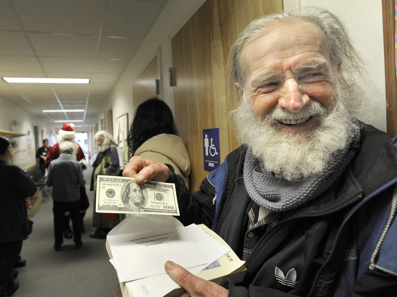 """""""I'm a rich man,"""" said Sean Donovan of Woolwich after an assistant for Portland's Secret Santa handed him a $100 bill Wednesday at the Mid Coast Hunger Prevention Program in Brunswick. In all, Santa planned to give away $20,000 in cash gifts in four Maine cities this week."""