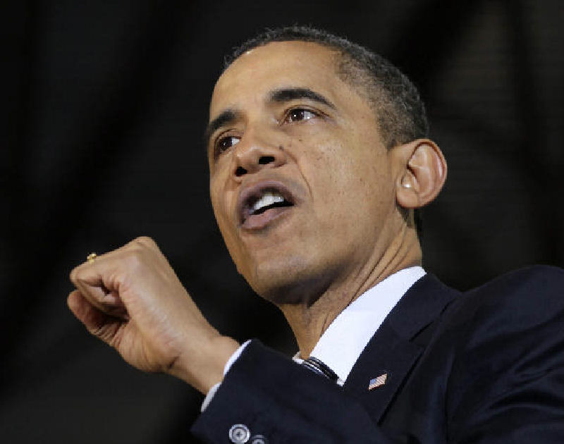 President Barack Obama speaks Dec. 6 at Osawatomie High School in Osawatomie, Kansas. Obama's signature health care law has increased coverage of young adults by 2.5 million.