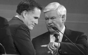 FORMER MASSACHUSETTS Gov. Mitt Romney, left, and former House Speaker Newt Gingrich talk at the end of the South Carolina Republican presidential candidate debate in Myrtle Beach, S.C., on Monday.