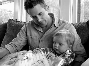 MATT HAMMITT reads a book to his 1-year-old son, Bowen, at their home in Perrysburg, Ohio, on Setp. 14, 2011. Hammitt, lead singer for the Christian rock band Sanctus Real, has released an album inspired by his son who was born with a rare heart defect.