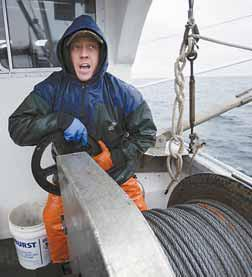 BRIAN HORTON tightens the brake on a winch after setting a shrimp net.