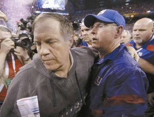 NEW ENGLAND PATRIOTS head coach Bill Belichick, left, turns away after greeting New York Giants head coach Tom Coughlin following the NFL Super Bowl XLVI football game on Sunday in Indianapolis. The Giants won 21-17.