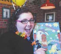 Caroline Hinkley, 17, of Brunswick shows off a personalized trip packet presented to her during a send-off party, also sponsored by the Make-A-Wish Foundation. (Courtesy of Kristie Hinkley)