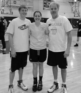 A TEAM FROM Richmond, from left, consisting of Brandon Lancaster and Brooke Lancaster, both of whom played basketball at Richmond High School, and Paul Lancaster, who coached Richmond High School boys basketball for two decades, was all smiles at the annual Swish-Out Childhood Cancer Challenge, coordinated by Maine's credit unions.