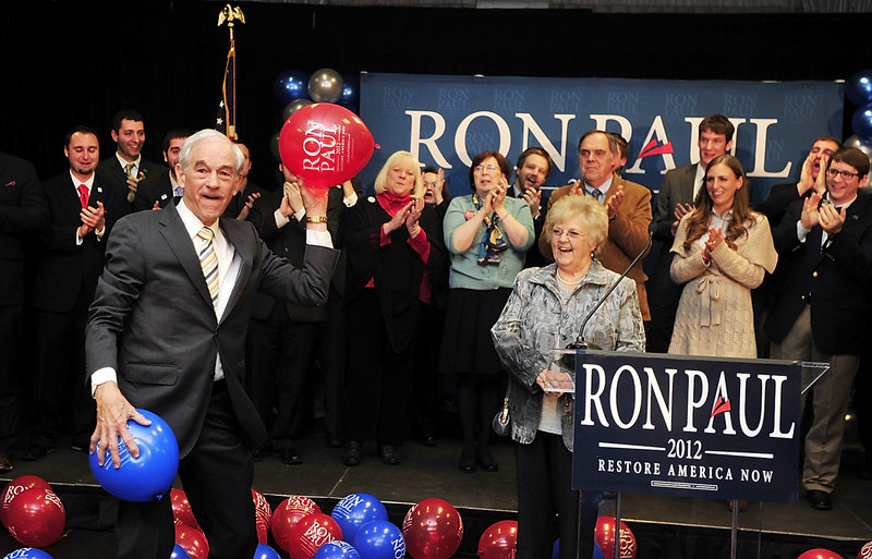 Republican presidential candidate Ron Paul tosses balloons to supporters Saturday night at the Seasons Event and Conference Center in Portland. His supporters and the Paul campaign say the cancellation of a local caucus meeting in Washington County robbed Paul of a victory over Mitt Romney.