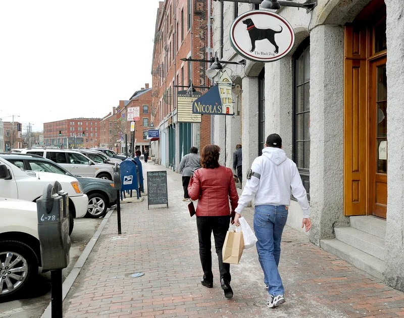 Businesses on Commercial Street in Portland draw shoppers on Friday. A commercial real estate survey shows the area along the waterfront has the lowest vacancy rate in the city.