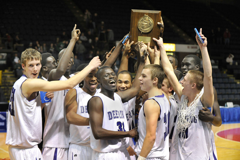 Deering players hold up their regional championship trophy after their dramatic victory over Bonny Eagle. The Rams will play Hampden Academy in the state final at 7 p.m. Saturday in Portland.