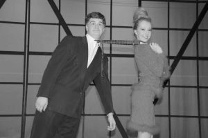 """JACK LABREQUE as J.B. Biggley and Annabelle Gardiner as Hedy LaRue star in the Brunswick High School Players' production of """"How to Succeed in Business Without Really Trying,"""" which opens at 7 p.m. today in Crooker Theater at the school on Maquoit Road. Additional performances are scheduled for 7 p.m. Friday, as well as 2 p.m. and 7 p.m. Saturday. The musical comedy, from the writers of """"Guys and Dolls,"""" spoofs corporate culture and """"get rich quick"""" thinking. Familiar songs from the show include """"The Brotherhood of Man"""" and """"I Believe in You."""" Tickets cost $8 for students or $10 for adults at the door. (Lifetouch photo)"""