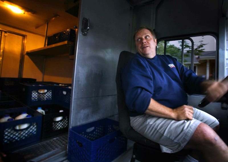 Jimmy Pastor makes early morning deliveries in his milk truck in Santa Ana, Calif. People with businesses where the bottom line is tied to gas prices, such as delivery services, are hit hard by rising fuel costs. 04000000 FIN krtbusiness business krtnational national krtedonly mct 04015003 04017000 AUT krteconomy economy krtnamer north america krttransportation transportation krtusbusiness road u.s. us united states 2012 krt2012