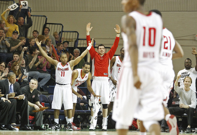 Players and fans react after Maine's Kenny Hayes, 10, hit a 3-pointer in the fourth quarter Sunday at the Portland Expo.