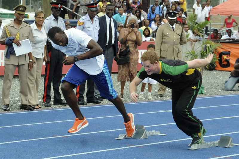 Britain's Prince Harry, right, and Olympic sprint champion Usain Bolt run a mock race in Kingston, Jamaica, on Tuesday. Harry was in Jamaica as part of a Diamond Jubilee tour.