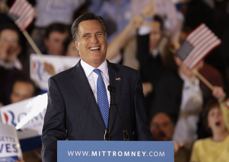 Republican presidential candidate Mitt Romney laughs while addressing supporters at his Super Tuesday campaign rally in Boston on Tuesday night.