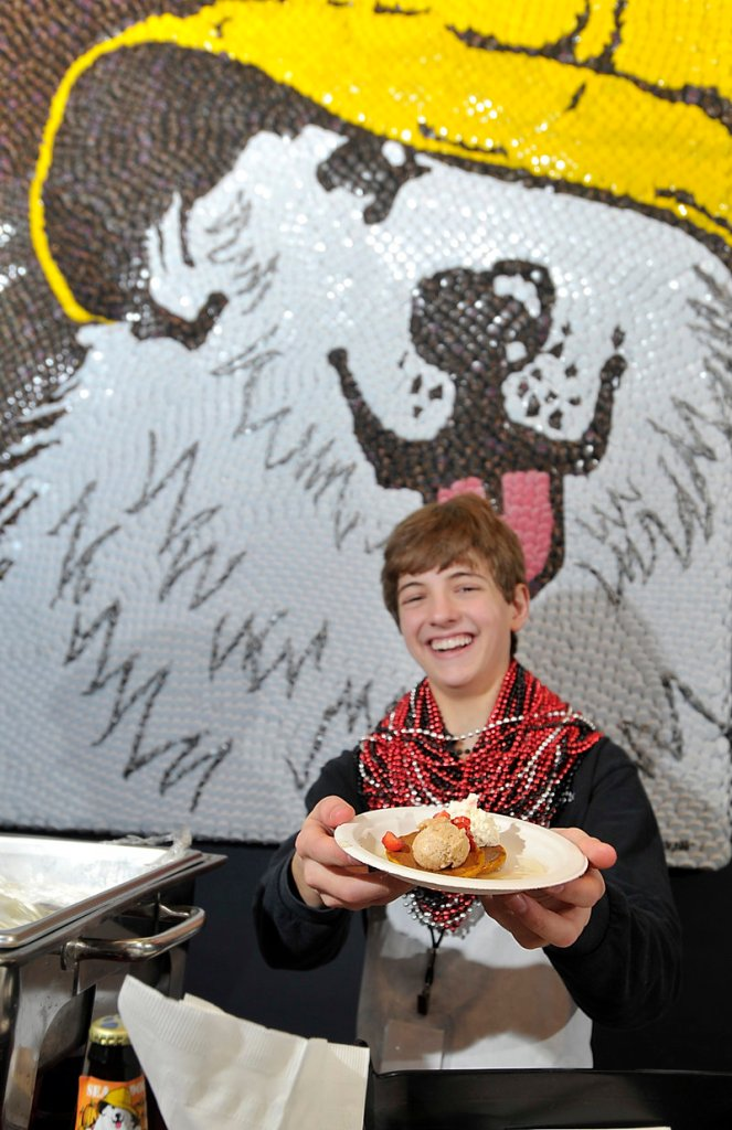 Chris Gordon, son of Sea Dog Brewing Co. Chef Reed Gordon, displays the popular pumpkin ale pancakes, which took second place at Friday's cook-off.