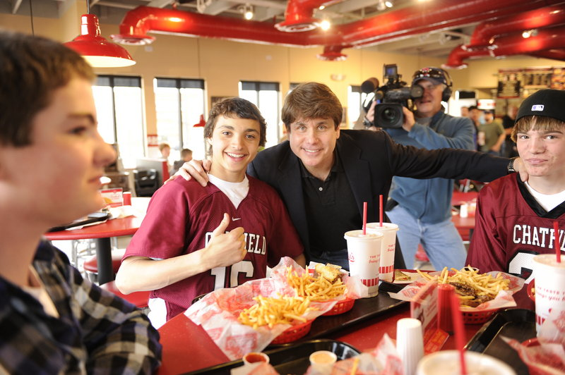 Rod Blagojevich poses Thursday with Chatfield High students, from left, Dylan Sorenson, Sage Dugas and Bryce Kuschel, at a Littleton, Colo., eatery where the former Illinois governor had lunch before turning himself over to the Federal Correctional Institution Englewood in Littleton.