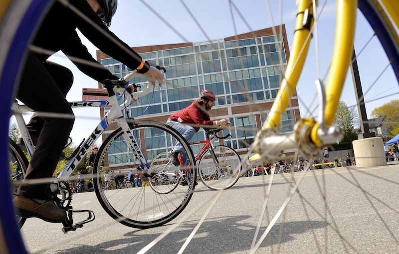 Participants try out bicycles in a University of Southern Maine parking lot Sunday during the Bicycle Coalition of Maine's Great Portland Bike Swap. About 2,000 people attended the swap. In all, there were about 1,000 used bikes available.