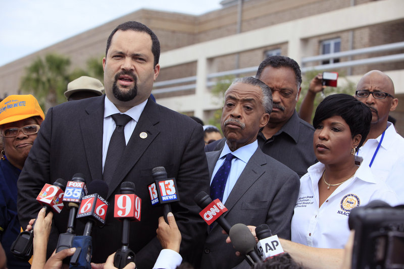 Benjamin Jealous, president of the NAACP, talks to the media as the Revs. Al Sharpton and Jesse Jackson, back, listen before a rally for slain Florida teenager Trayvon Martin last month in Sanford, Fla. As in other high-profile cases, the media presents what evidence it can gather, but experts caution that the public gets an incomplete picture.