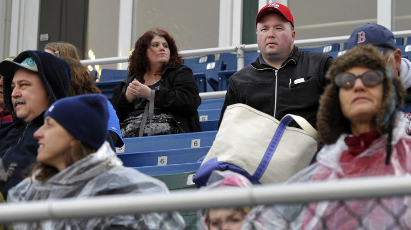 Kevin Davison waits for the Portland Sea Dogs' Opening Day game to start Thursday. He drove nine hours from his hometown of Halifax, Nova Scotia.