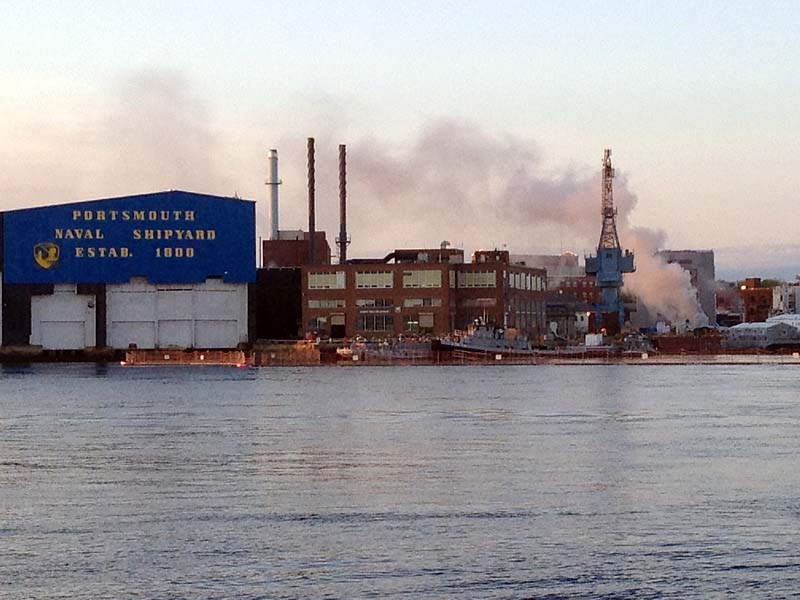 A fire burns on a nuclear submarine at the Portsmouth Naval Shipyard in Kittery on Wednesday.