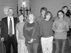 THE REV. CHRISTINA COUCH, second from left, has been hired as the new pastor of the Bowdoinham Church of the Nazarene. She previoously was assistant pastor of the Windham Church of the Nazarene. Her husband, the Rev. Dan Couch, left, was the pastor of the Saco Church of the Nazarene for several years. The Couch family lives in Freeport.