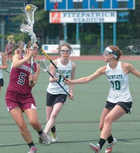 FREEPORT HIGH SCHOOL'S Katie Turner (5, top photo) gets off a shot while being chased by Waynflete's Amelia Deady (10) and Sadie Cole (14) in the State Class B girls lacrosse championship at Fitzpatrick Stadium in Portland on Saturday. In the middle photo Falcon captains (from left) Turner, Mia Thomas and Jess Hench receive the runner-up plaque after the 16-5 loss; and Meredith Broderick (1) gets around Waynflete's Martha Veroneau.