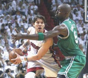 MIAMI HEAT'S Mike Miller (13) looks to pass as Boston Celtics' Kevin Garnett (5) defends during the first half of Game 5 in their NBA basketball Eastern Conference finals playoffs series on Tuesday in Miami.
