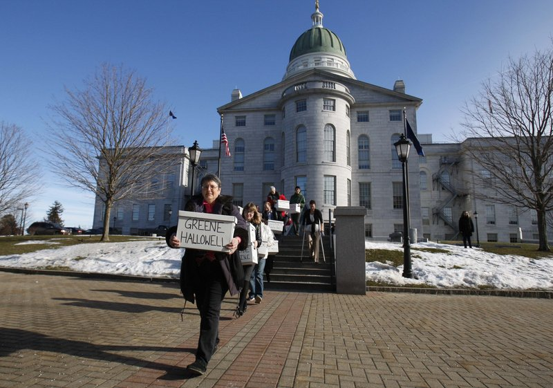 """Same-sex marriage backers carry signed petitions to the Maine Secretary of State's Office on Jan. 26. A Lyman Catholic says he's proud that the Maine diocese won't be participating in a """"second collection"""" Sunday to fund efforts to thwart gay marriage."""