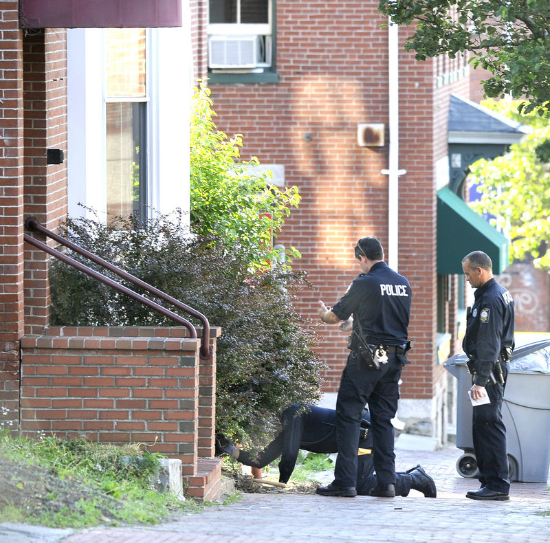 Police look for evidence at 105-107 India St. Matthew Blanchard, the shooting victim, was in the news last month when he crashed his car in Falmouth, killing his passenger.