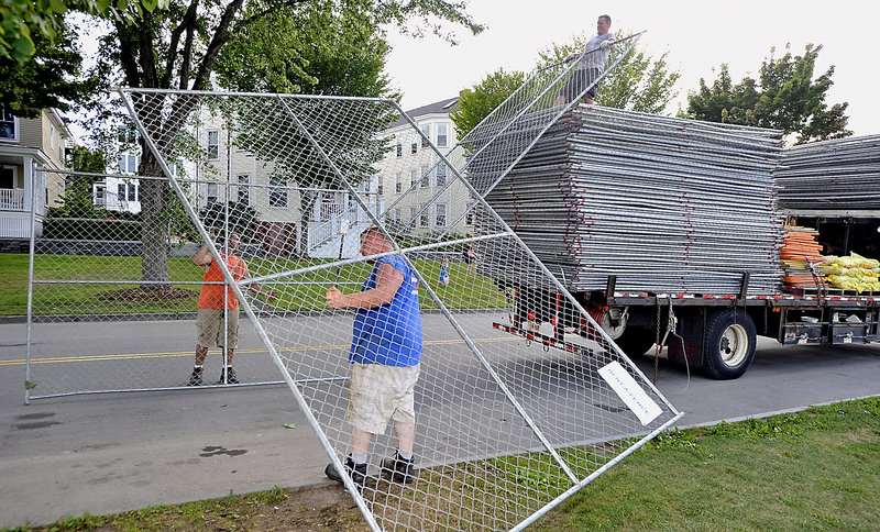 A crew from National Rent-A-Fence stacks for transport the last 1,300 feet of fencing used for Saturday's Mumford & Sons concert on the Eastern Prom. The company, from Southborough, Mass., used 5,800 feet of fencing for the show.