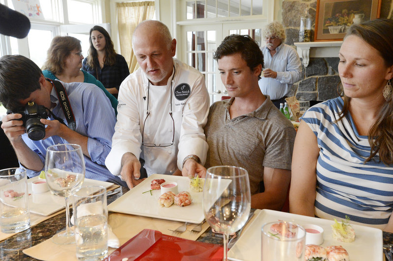 Patrick Goubier, the chef from Chez Patrick in Hong Kong, serves his dish – lobster, goat cheese, red beet soup and Chinese black beans – to judges during the final heat in the Shucks Maine Lobster Chef World Series on Wednesday in Scarborough.