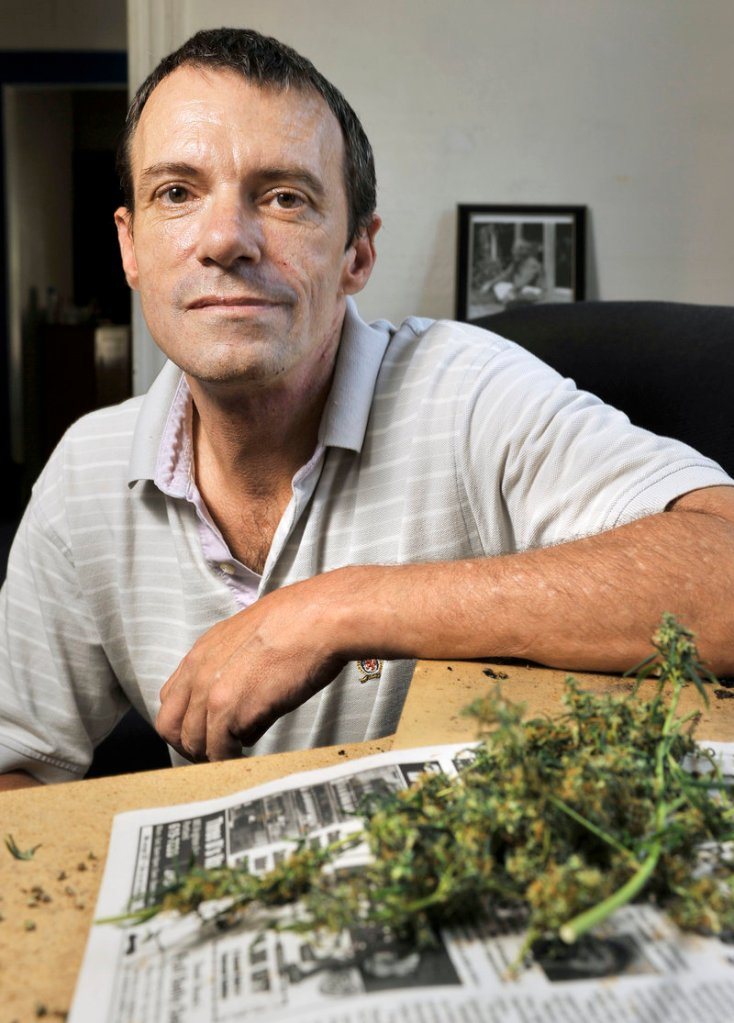 Charles Wynott, organizer of Saturday's CannaFEST event in Deering Oaks park, displays some of the marijuana he grows at home to treat a medical condition. He has a city permit for the festival and expects 200 to 300 people to attend.
