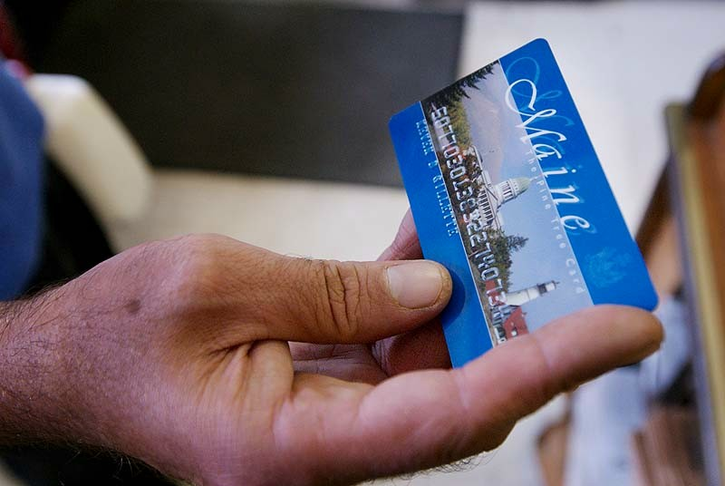 In this August 2008 file photo, Keven Gillette of Portland uses a magnetic food stamp card to buy his groceries. Maine food-stamp recipients who erroneously received extra benefits last year will not be required to repay the government, according to a letter sent this week to Department of Health and Human Services Commissioner Mary Mayhew.