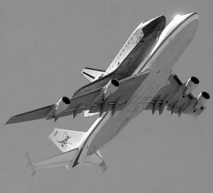 THE RETIRED SHUTTLE Endeavour piggy-backs aboard a modified Boeing 747 shuttle carrier during its final flight Thursday as the pair soar over White Sands Missile Range east of Las Cruces, N.M., before heading to California.
