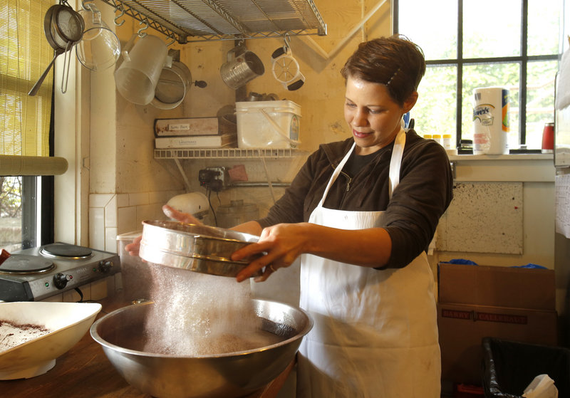 "Tara Smith sifts flour into a brownie mixture at Standard Baking Co. in Portland. ""Standard Baking Co. Pastries"" by Smith and Alison Pray is due out on Oct. 15. The book features many of Standard Baking's most popular items with photography by Sean Alonzo Harris."