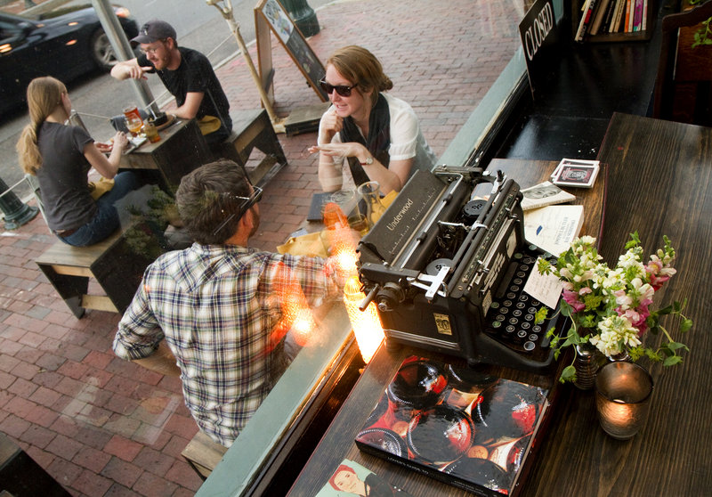 Daniel Liebowitz and Ariel Solaski of Vermont enjoy streetside dining at LFK, a literary hangout decorated with a number of old typewriters and books.