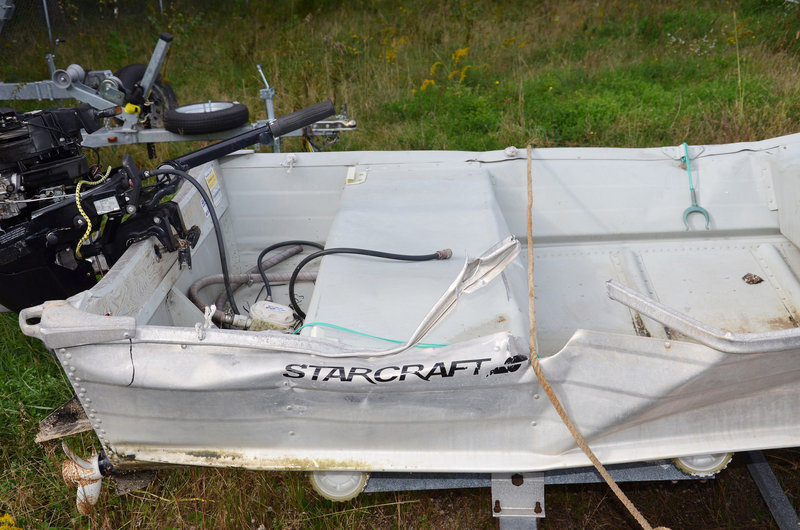 A 14-foot aluminum skiff shows damage from the fatal collision with a cabin cruiser near Littlejohn Island on Friday.