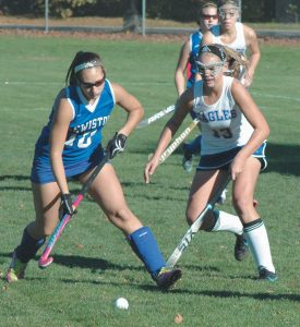 MT. ARARAT'S Micaela Mitchell (13) defends against Lewiston's Janessa Talarico during an Eastern Maine Class A high school field hockey quarterfinal contest in Topsham on Wednesday. The host Eagles rolled to a 4-0 victory. For complete game coverage, turn to B1.