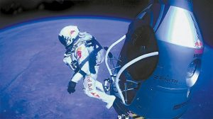THIS IMAGE provided by Red Bull Stratos shows pilot Felix Baumgartner of Austria as he jumps out of the capsule during the final manned flight for Red Bull Stratos on Sunday.