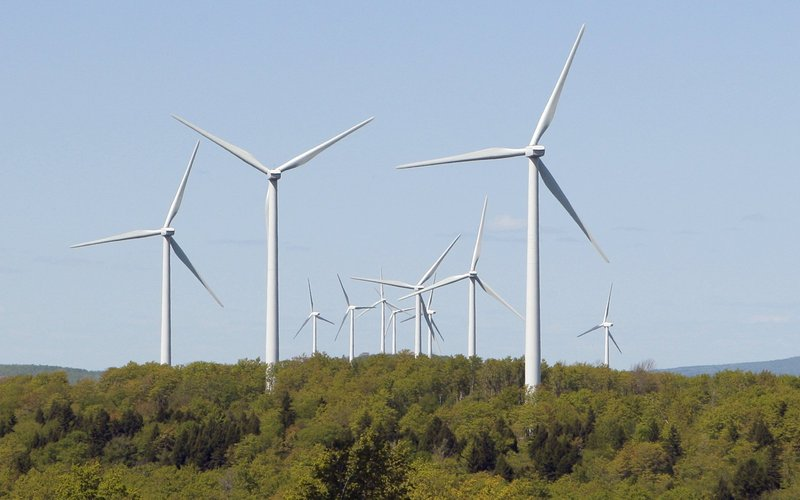 Turbines tower over the landscape at the Stetson wind farm in Danforth. The benefits of wind energy have been exaggerated, and the costs have been largely overlooked, readers say.