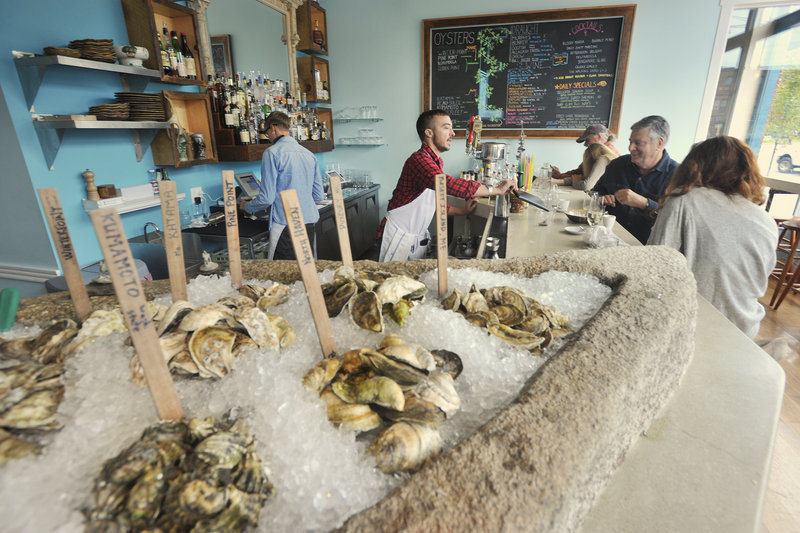 "At Eventide Oyster Co., wooden sticks mark the varieties like a bivalve garden plot. Diners can try a half- or full dozen ($15 and $27), grouped by ""Maine"" and ""From Away,"" accompanied by Mimosa Mignonette, Tomato Water or Horseradish Ice."