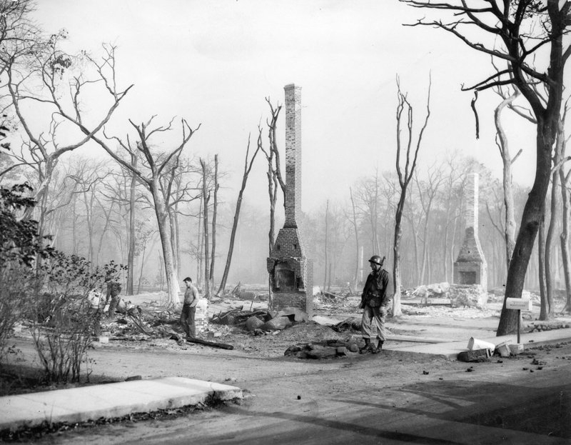 Only chimneys remain from houses consumed by one fire. Overall, more than 1,100 houses were destroyed.