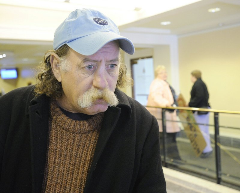 Steve Huston of Portland waits at the State House in Augusta to speak against cuts in health care last December. He died unexpectedly Thursday.