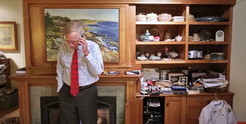Angus King talks on the phone with his daughter, Molly, after returning home from campaigning last week. Molly, a freshman in college in New York, asked about what King thought of a candidate forum earlier that day and for pictures of the family pets.